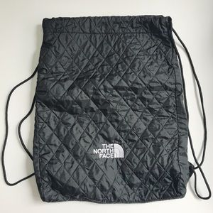The North Face quilted backpack.